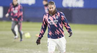 Real Madrid captain Sergio Ramos assesses the conditions