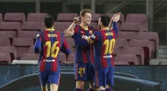 Lionel Messi celebrates his second goal with Frenkie de Jong